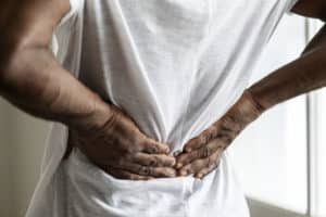 A man suffering sciatica symptoms