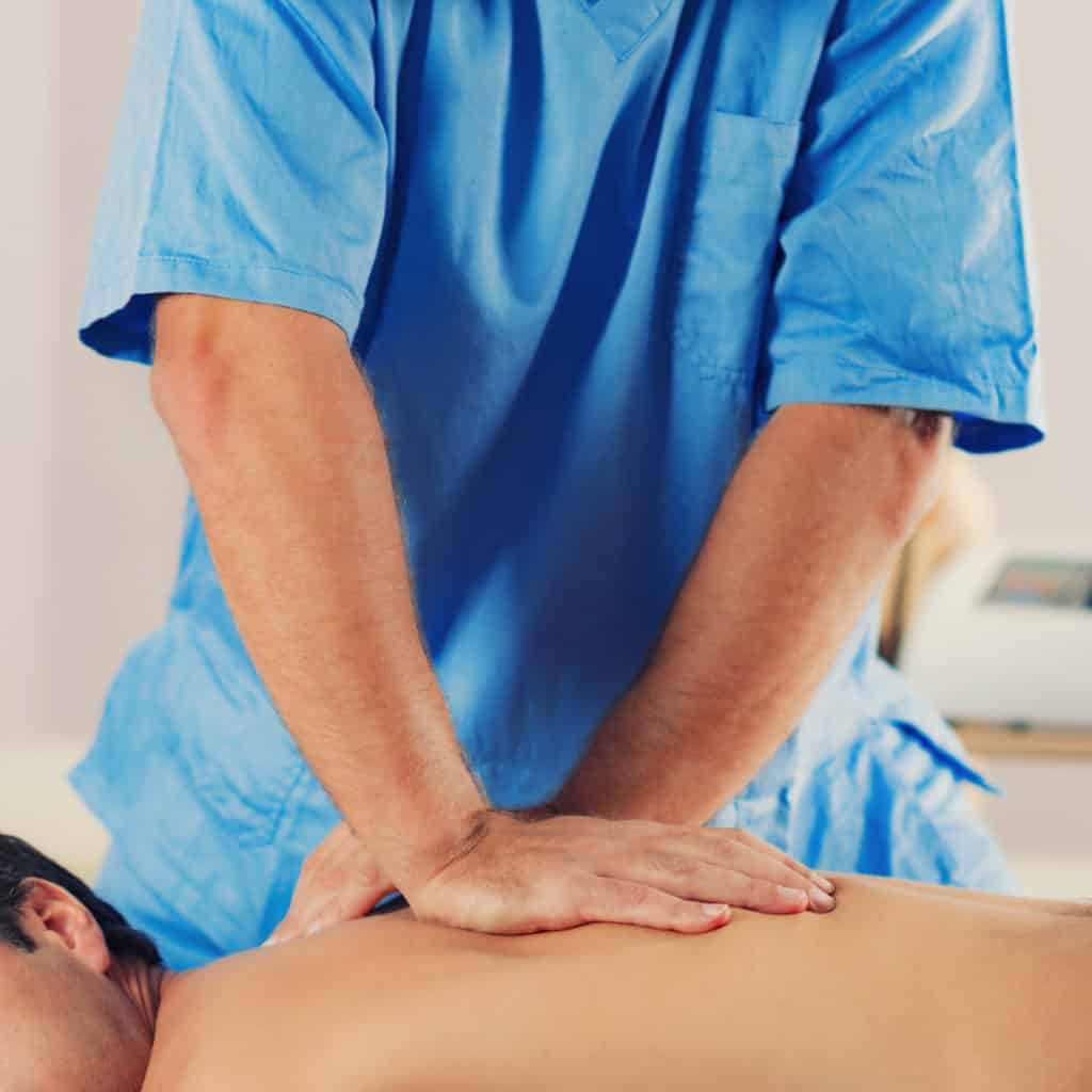 Man getting chiropractic care for sciatica