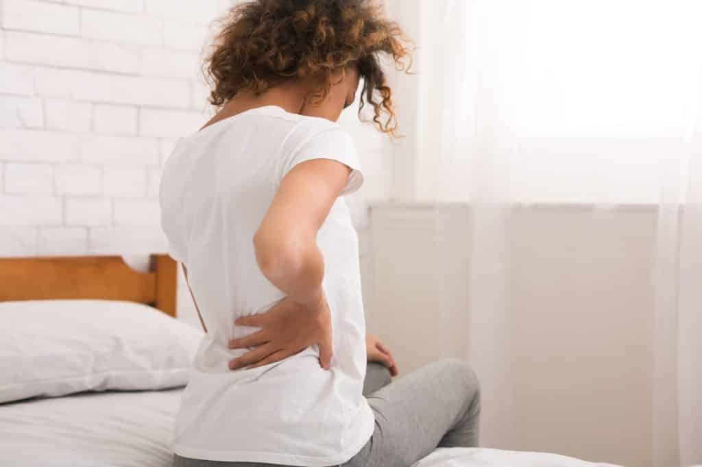 Woman experiencing sciatica nerve pain symptoms